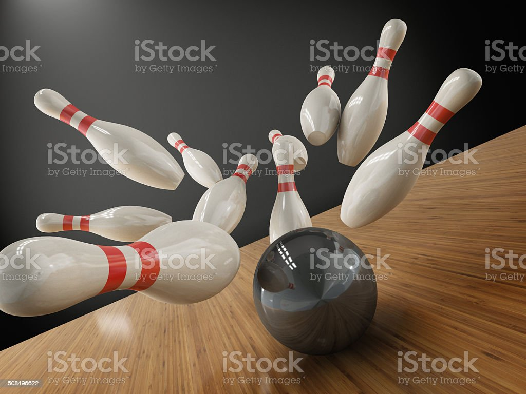 scattered skittle and bowling ball on white background stock photo
