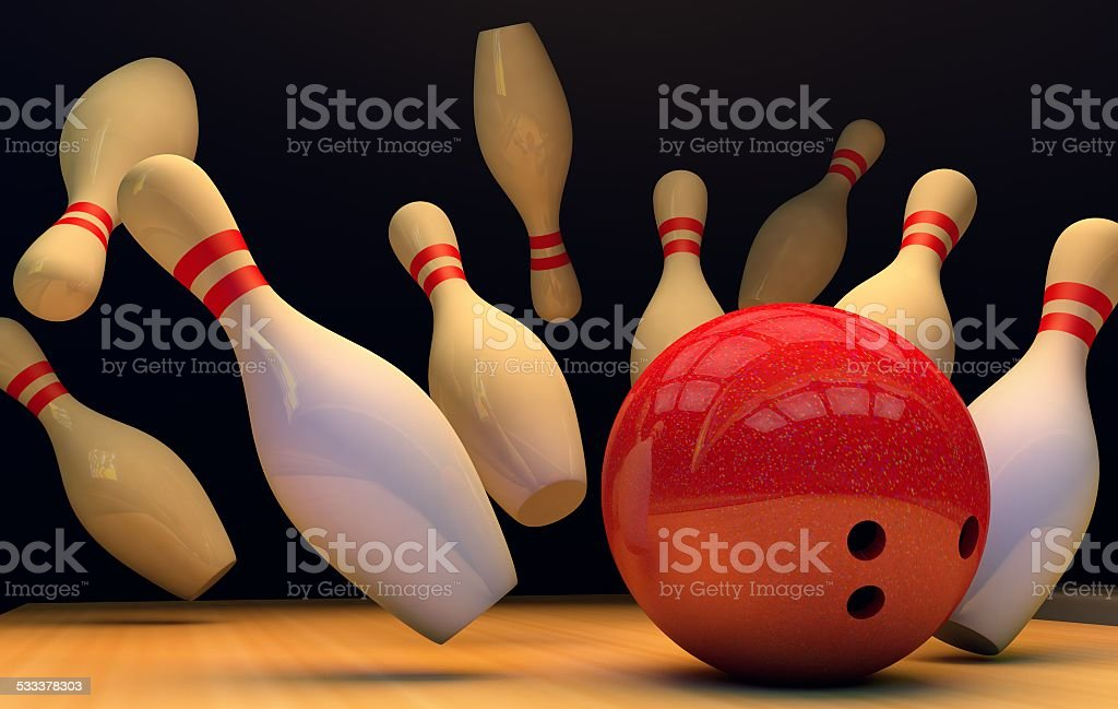 scattered skittle and bowling ball on wooden floor stock photo
