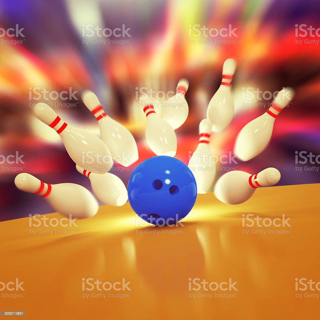 Scattered skittles and bowling ball stock photo