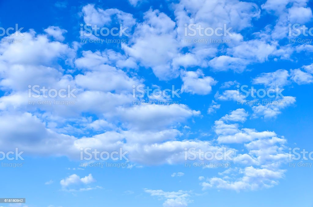 Scattered white clouds in a blue sky royalty-free stock photo