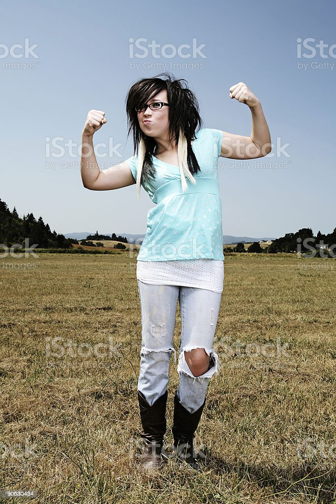 Scene Girl Acting Tough in a Field royalty-free stock photo