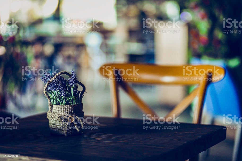 Scene in a sunny restaurant with flowers stock photo