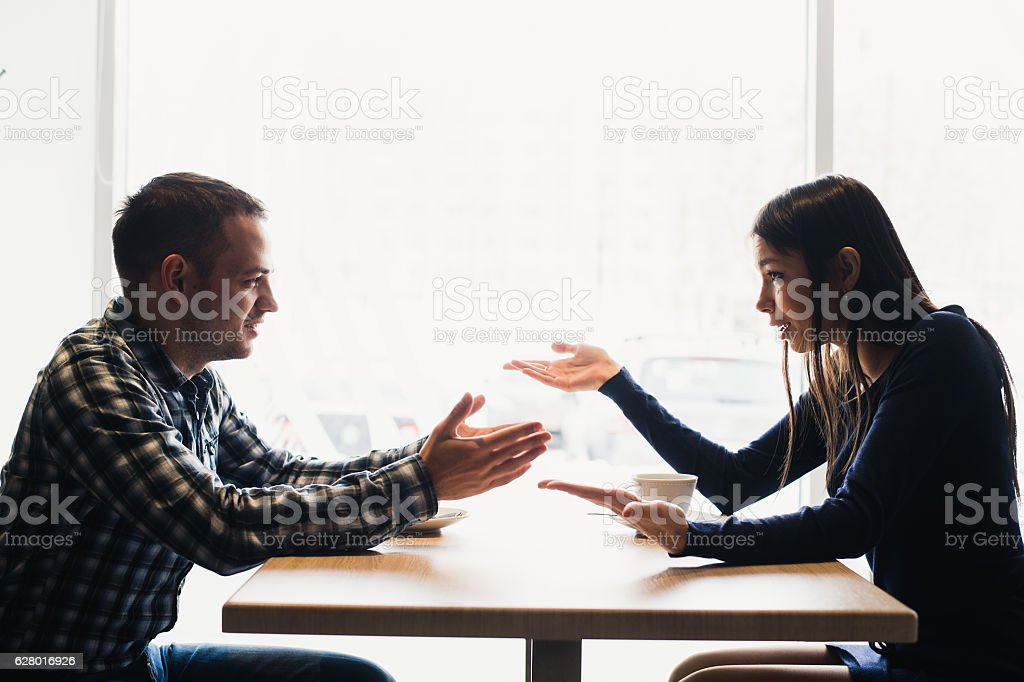 Scene in cafe - couple conflict arguing during the lunch. stock photo