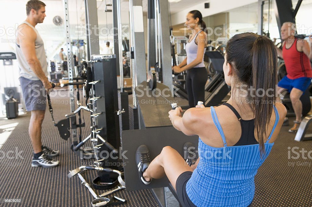 A scene in the gym with people doing training exercise  stock photo