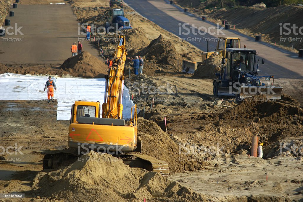 Scene of construction of new highway with heavy equipment stock photo