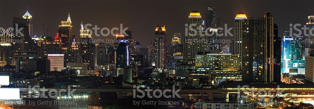 Scene of high-rise buildings and sky train railway at dusk stock photo