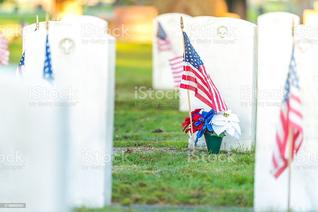 scene of military graveyard landscape with a flag on autumn. stock photo