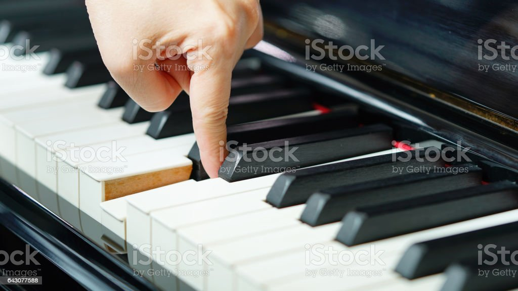 Scene of pianist hands from beside angle playing piano stock photo