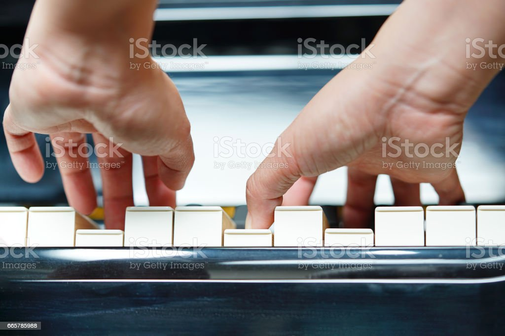 Scene of pianist hands from underneath. stock photo