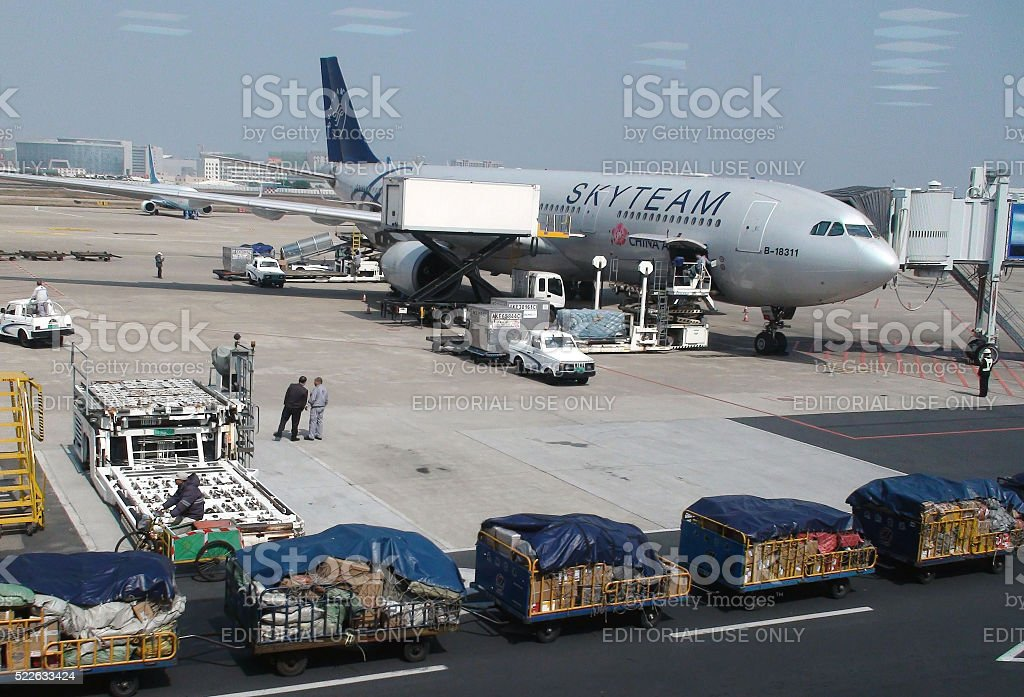 Scene Of Process Of Loading China Airlines By Ground Crew stock photo