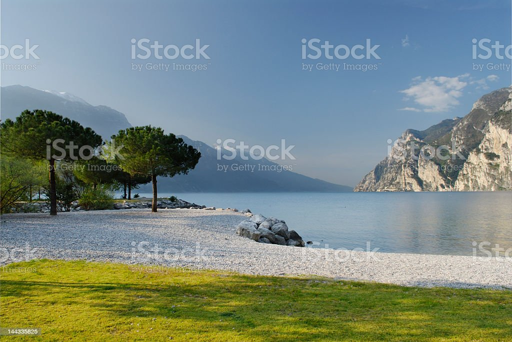 Scene of Riva Del Garda featuring water and mountains stock photo