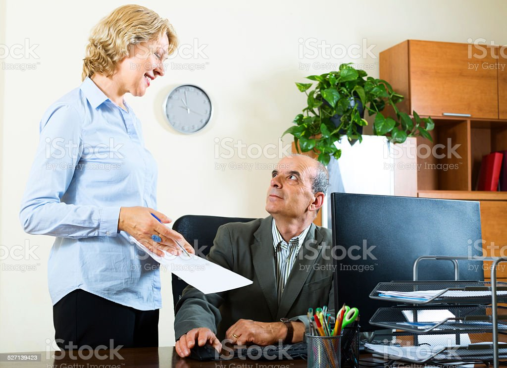 scene of two aged and happy co-worker stock photo