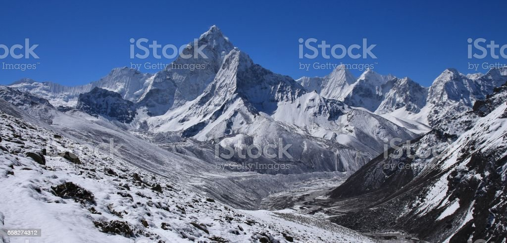 Scene on the way from Dzongla to Lobuche, Everest National Park. Mount Ama Dablam and other high mountains. stock photo