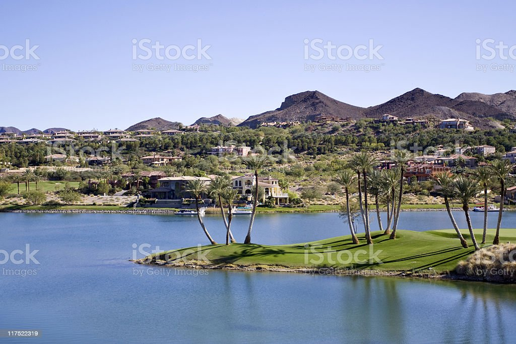 Scene overlooking a desert oasis featuring the water royalty-free stock photo