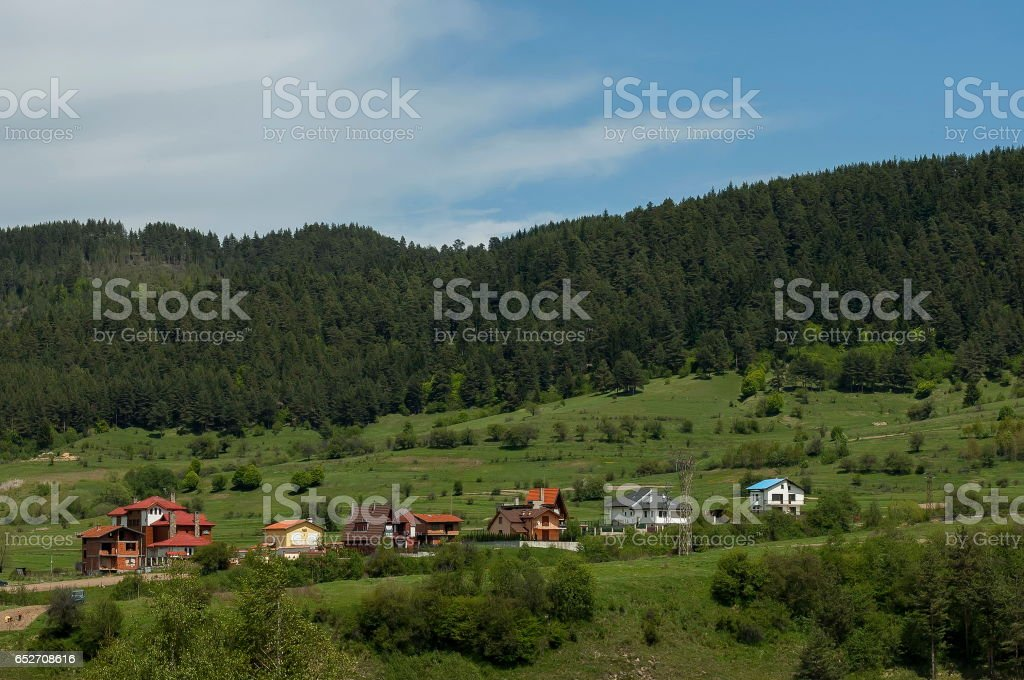Scene with mountain top, valley and residential district of bulgarian village Beli Iskar, Rila mountain stock photo