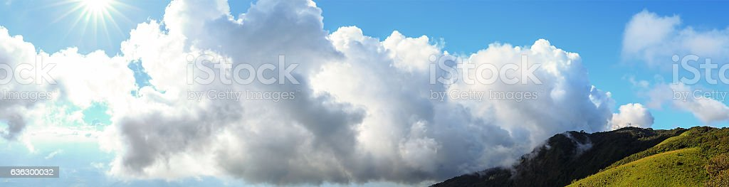 Scenery and bright sky with sunlight over mountain stock photo