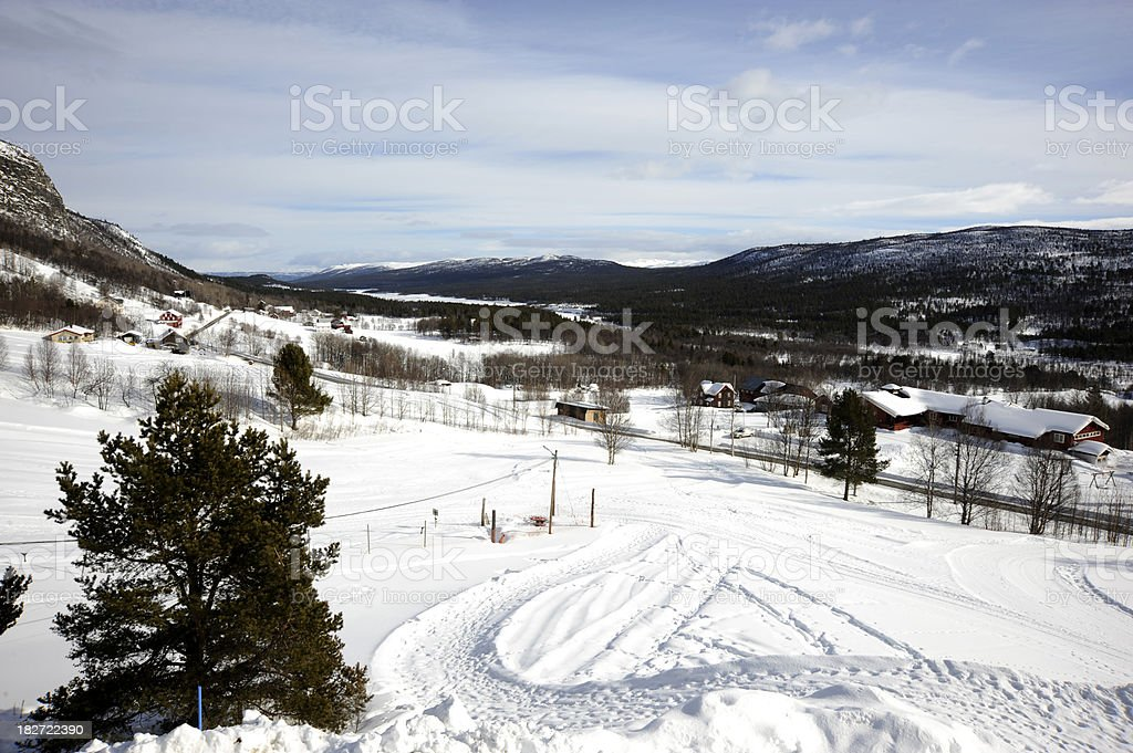 Scenery of a Norwegian farm under snow stock photo