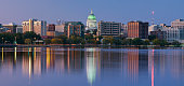 Scenery of Madison with a lake and tall office buildings