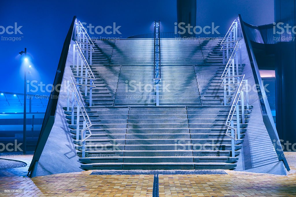 Scenery with stairs from Odense city foggy night in january stock photo