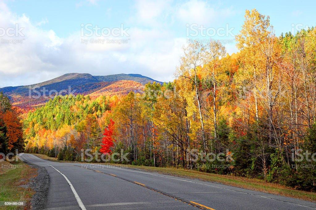 Scenic Autumn road in the Adirondacks region of New York stock photo