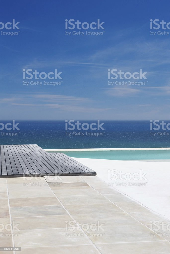 Scenic beach with calm clear water and swimming pool royalty-free stock photo