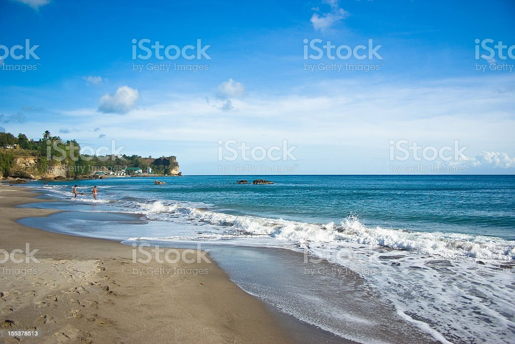 scenic caribbean beach and distant couple stock photo