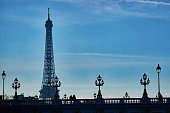 Scenic cityscape of Paris with people silhouettes and Eiffel tower