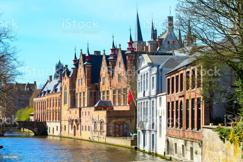 Scenic cityscape with houses, bridge and Green canal, Groenerei in Bruges, Belgium stock photo