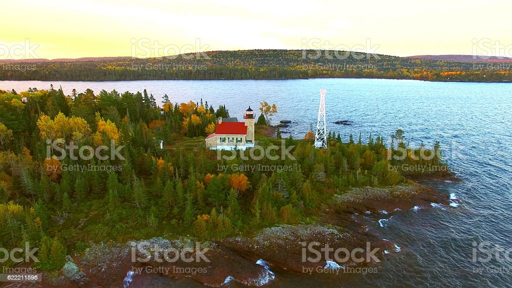 Scenic Copper Harbor Michigan lighthouse with Autumn colors, at dawn stock photo