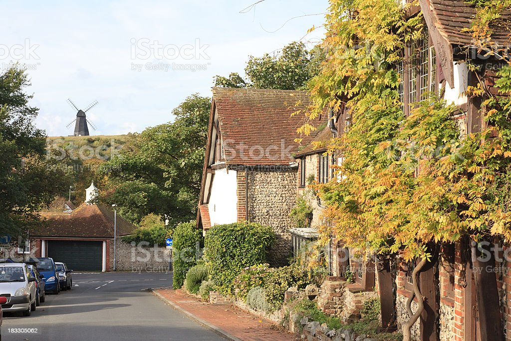 Scenic English village and windmill, stock photo