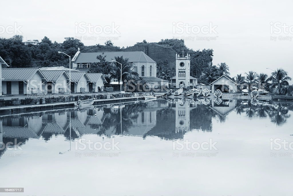 scenic fish landing facility reflected in water stock photo