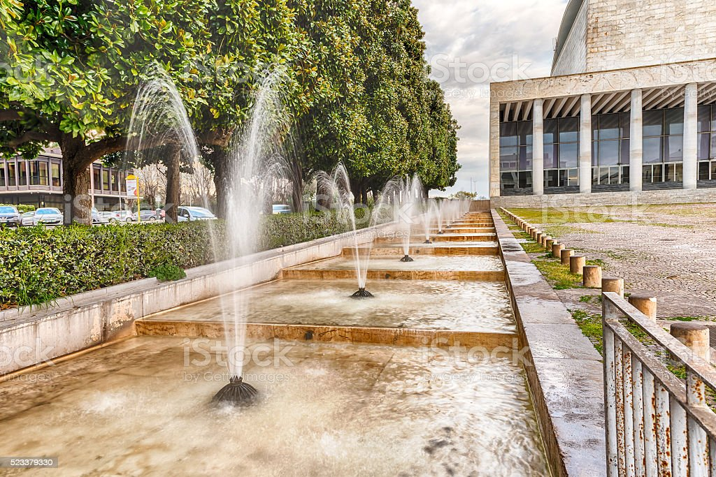 Scenic fountain, neoclassical architecture in the EUR district, stock photo