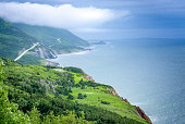 scenic  green lands and road of Cape Breton