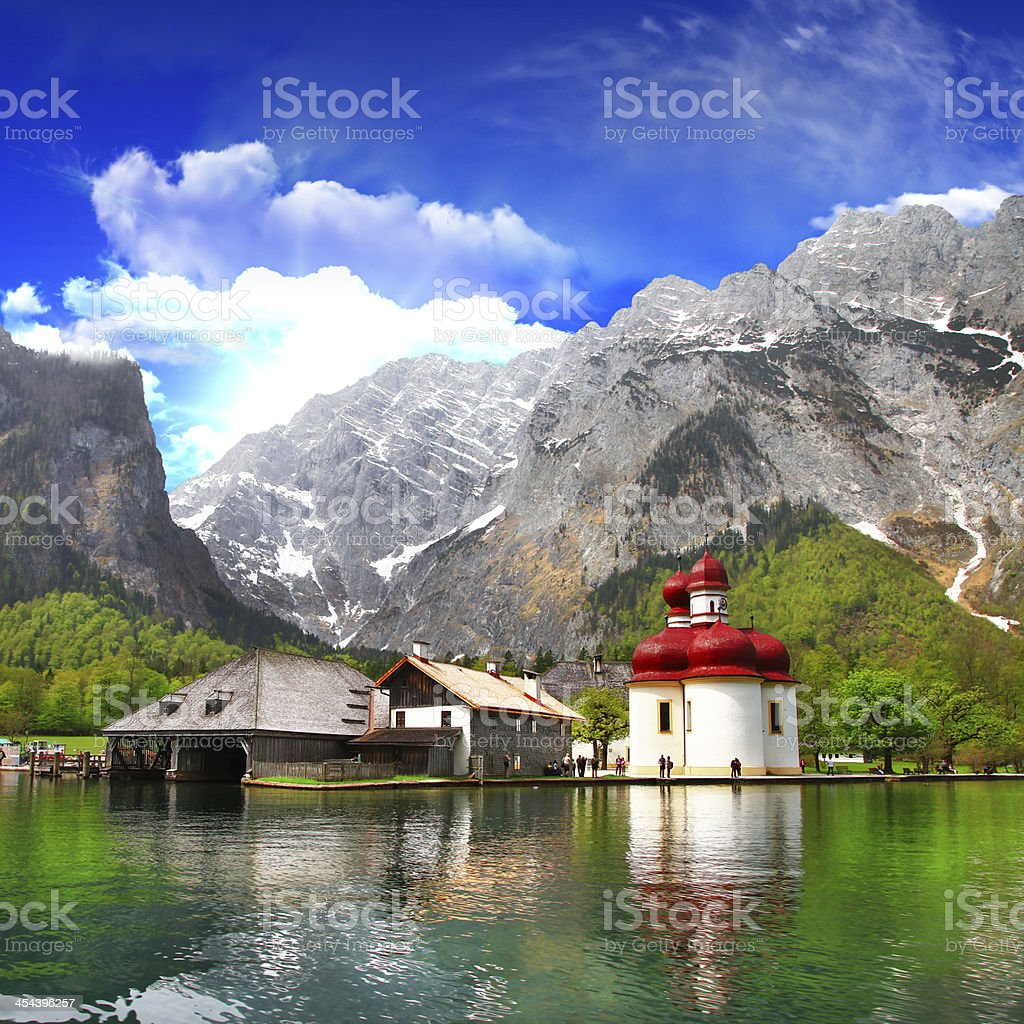 Scenic image of a cottage by the Alpine Lake stock photo