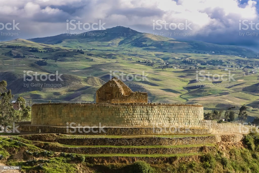 Scenic Inca ruins of Ingapirca and surrounding green andean landscape with dramatic sky stock photo