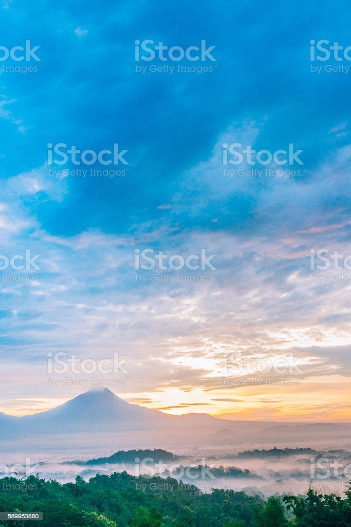 Scenic Java Indonesia Sunrise Behind Mount Merbabu Volcano Landscape stock photo