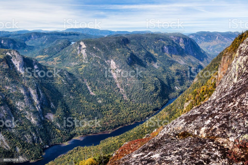 Scenic landscape in autumn on top of mountain with colorful trees stock photo