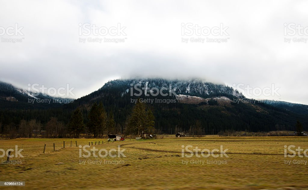 Scenic landscape of the cloud covered Alps in Austria stock photo