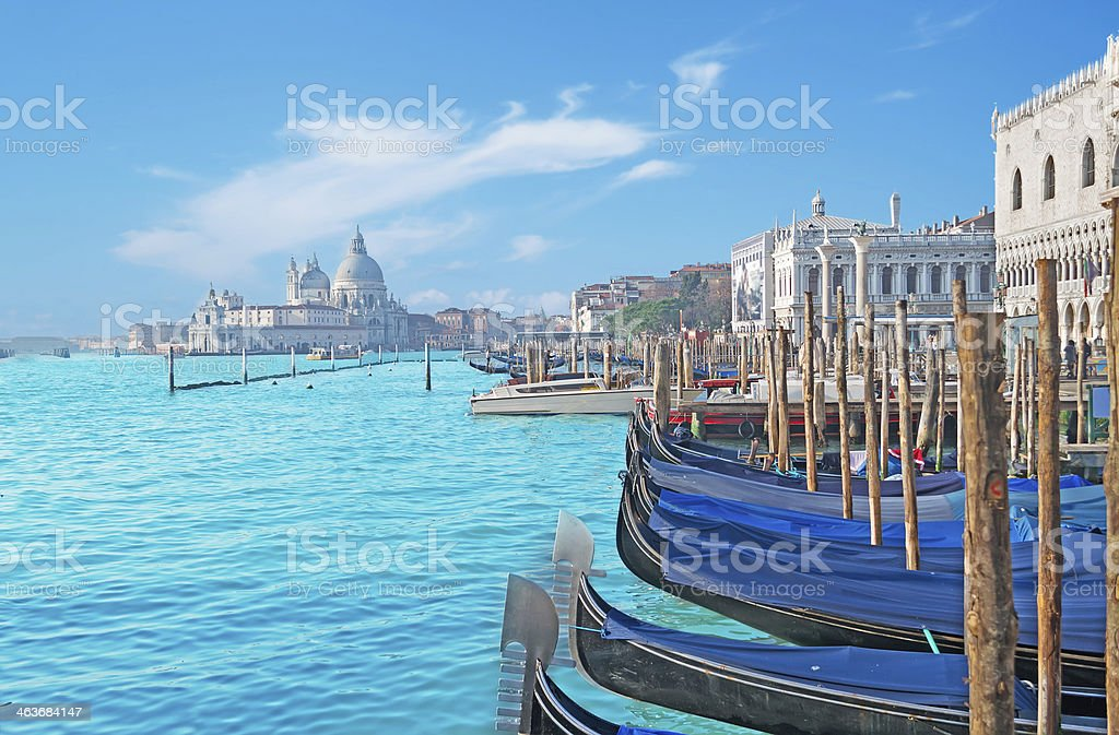 Scenic landscape with gondolas in Venice on blue water stock photo