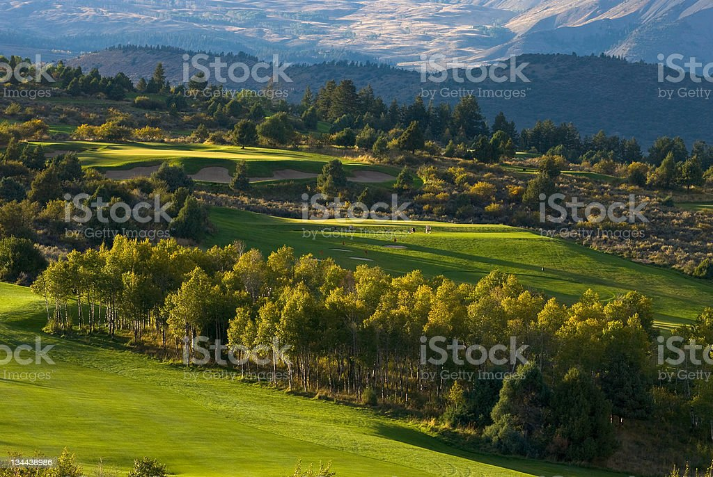 Scenic Mountain Golf Course Green at Sunset in Autumn royalty-free stock photo