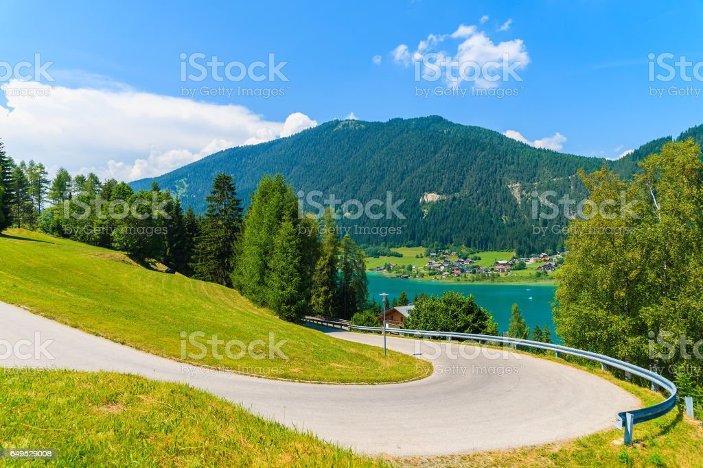 Scenic mountain road along Weissensee lake in summer landscape of Carinthia region, Austria stock photo