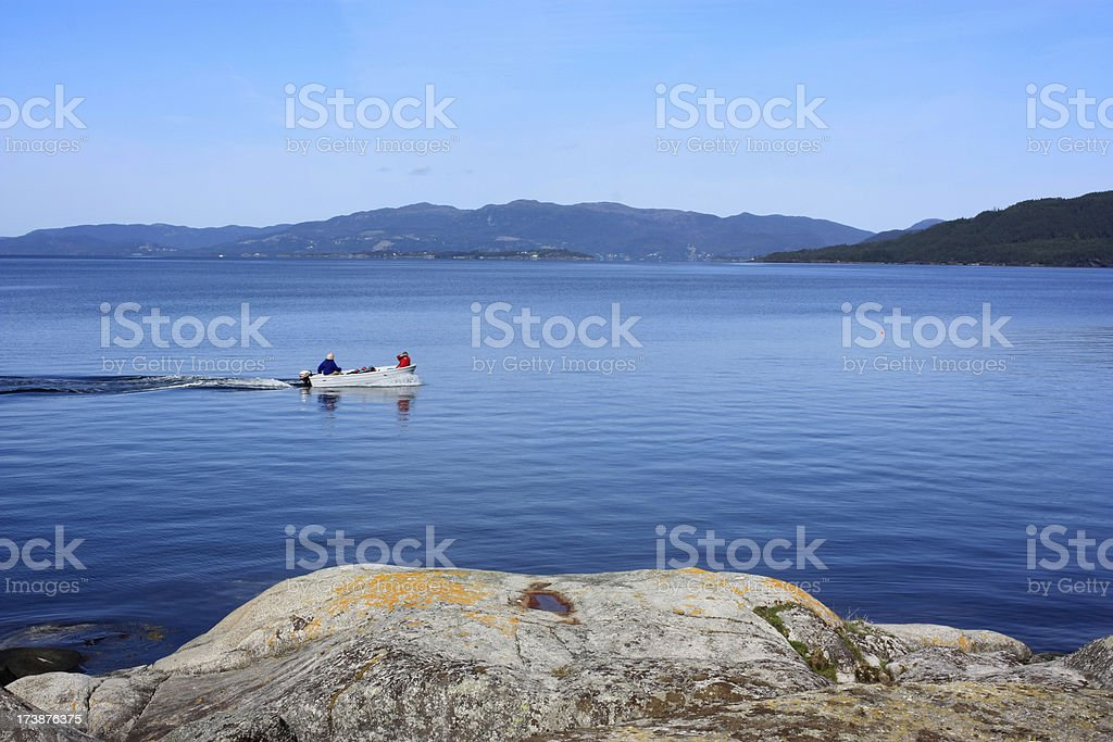 Scenic Nordic Fjords with boaters stock photo