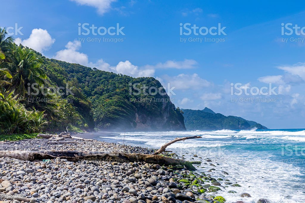 scenic ocean landscape in Dominica with huge waves stock photo