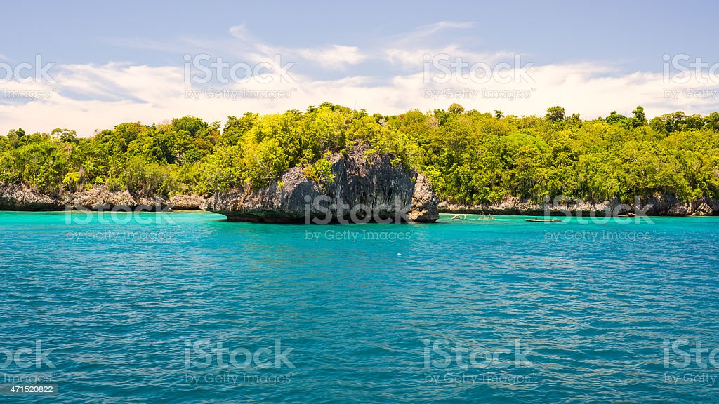 A scenic photograph of the coastline in Togian Archipelagi stock photo