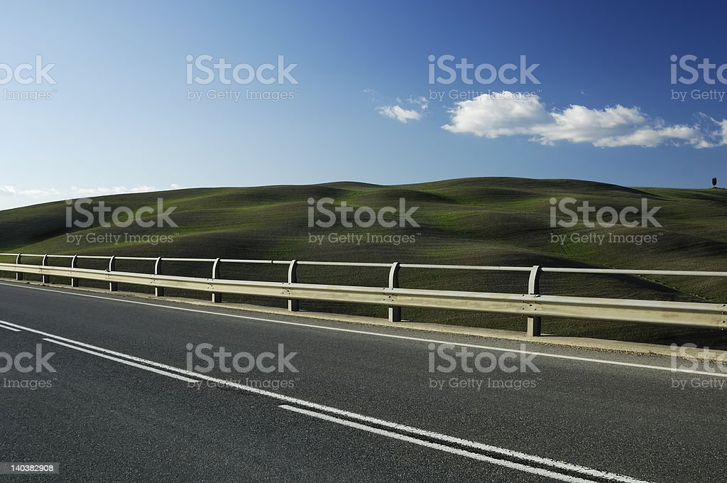 scenic road suspended on waved green hills royalty-free stock photo