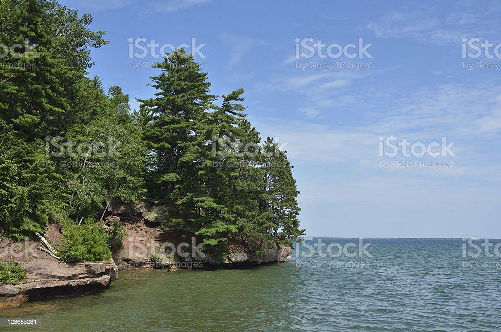 Scenic Rocky Shoreline on a Sunny Summer Day royalty-free stock photo