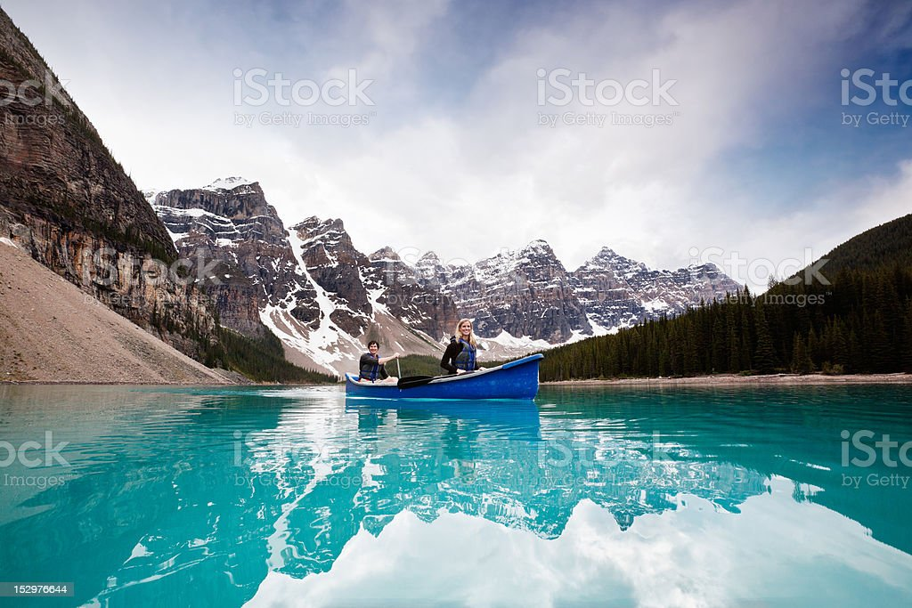 Scenic shot of couple sailing on calm water stock photo