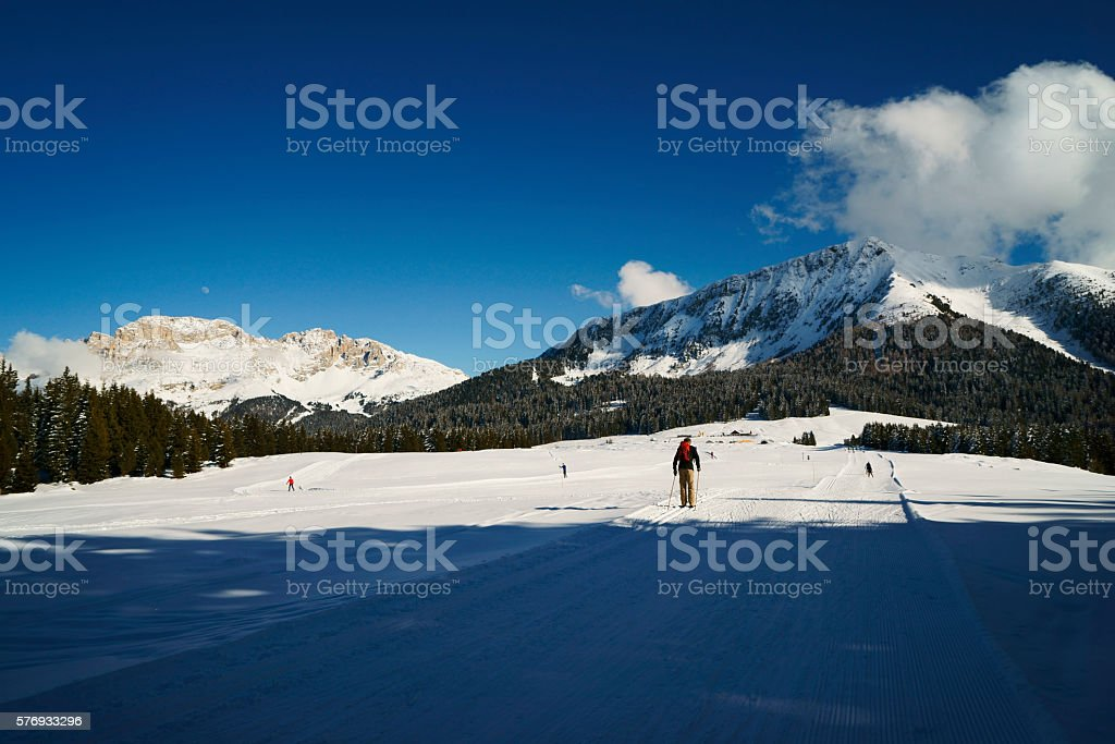 scenic snow covered winter landscape with mountains and ski track stock photo