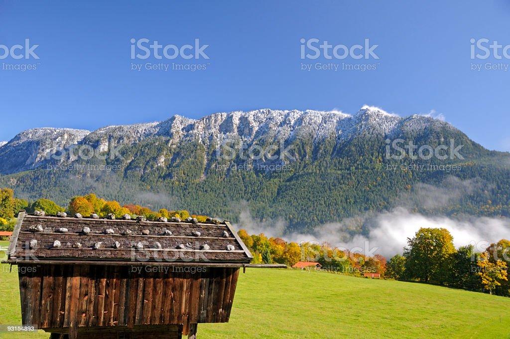Scenic snow powdered mountain ridge, a landscape in autumn colors stock photo