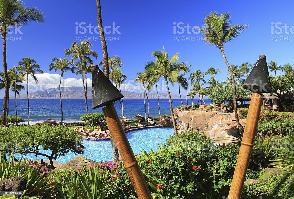 Scenic swimming pool in Maui Hawaii resort in Pacific Ocean stock photo